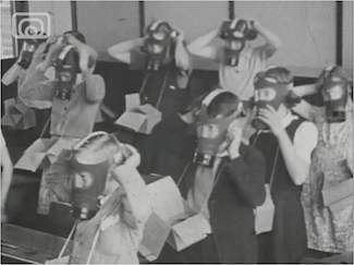Children wearing gas masks