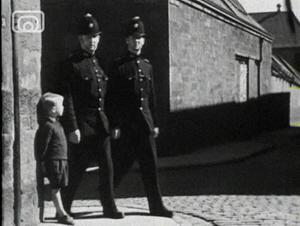 Still frame from 'Children of the City'