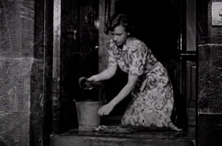 Woman scrubbing front step