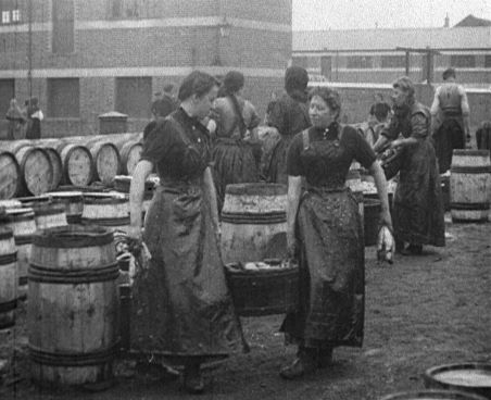Women carrying basket of herring